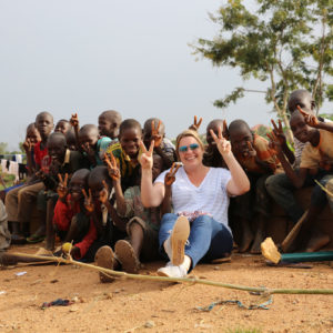 Muffy sitting with children at the Favoured Sisters orphanage in Nigeria.