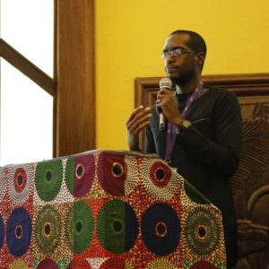 """Umar Turaki, Head Writer & Director of """"In Love & Ashes,"""" speaking at the conference."""